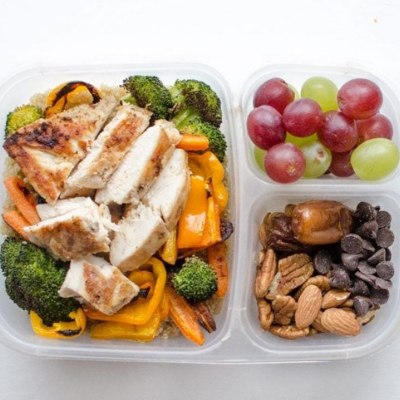 cooked quinoa roasted veggies and chicken breast bento box