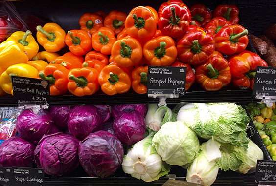 bell peppers, cabbage and other vegetables in grocery store